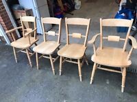 Four farmhouse style pine chairs (2 captain's chairs with arms and 2 without arms)