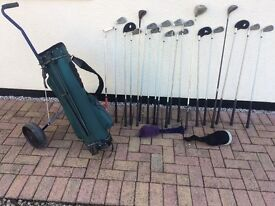 Golf clubs and trolley for sale.