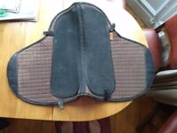 Barefoot saddlery, two saddle pads and a leather seat pad