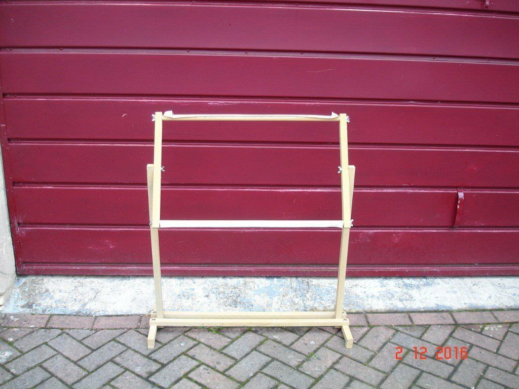 "workstation / easel / adjustable wooden stand. Base measures 33"" x 12"""