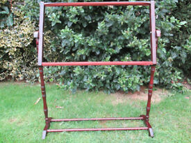 cross-stitch frame on stand