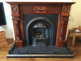 Cast iron fireplace with carved mahogany surround including , fender, gas fire, grate & mirror