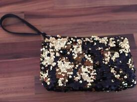 Gold and black small bag