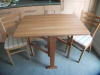 Space saving Isherwood Drop Leaf Dining Table and Two Upholstered Chairs in Excellent Condition