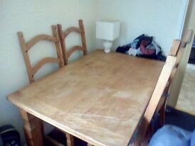 SOLID OAK TABLE AND FOUR CHAIRS WITH CUSHIONS