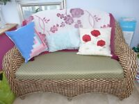 4 piece conservatory furniture. Two seater settee, 2 chairs and coffee/lamp table. Padded seats .