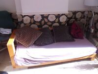 Wooden framed sofa bed with all cushions, good condition - collect from Maidstone Kent ME14