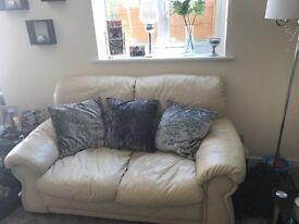 FREE 2 seater cream leather sofas