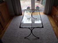 A Contemporary Glass and Metal Coffee Table