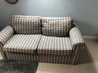 Sofa bed in blue and pink fabric