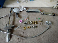 Assorted shower parts: 2 bar showers, shower riser, shower head, shower hose