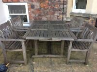 Solid teak table and 4 chairs in need of tlc but will be worth it