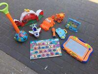 Bundle of children's toys, many electronic.