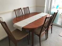 Extendable wood dining room table with 6 chairs
