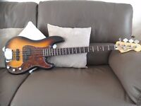 For sale,a Squier by Fender vintage modified precision bass with Spider hard case