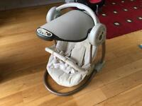 Mamas & Papas musical automatic so Baby swing seat.