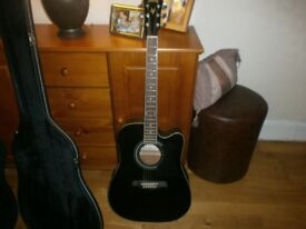Ibanez electric acoustic guitar and hard bodied case