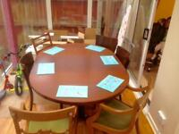 Large extendable wooden oak table with 6 antique chairs
