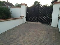 Driveway Wrought Iron and Hard Wood Gates with Electric Arms