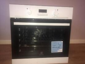 ELECTROLUX White Integrated Single fan assisted oven with white gas hob, extractor fan hood white.