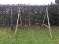 Outdoor wooden swing set.