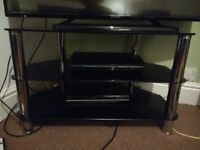TV stand, black glass and chrome.