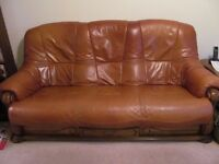 Brown leather suite and lamp tables