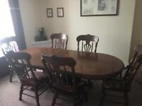 Solid wood table and chairs with matching wall unit.