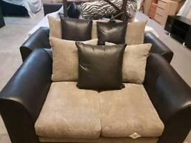 A brand new stylish black x grey 3x2 seated sofas.