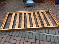 Single solid wood trundle bed with gold down legs and mattress. Good clean condition.