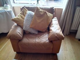 2 x 2 seat sofas & an armchair in a rustic orange colour for sale.