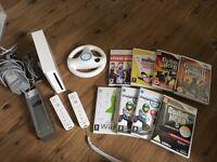 Nintendo Wii - guitar hero, mario kart and wii fit