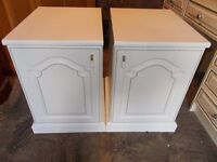 A heavy duty matching pair of bedside cabinets