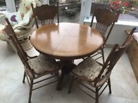 Extendable Dining Table and 4 Carved padded chairs