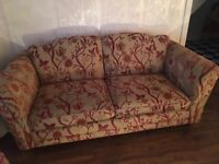 Red and cream cloth sofa and chair