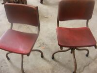 a pair of vintage steel frame industrial swivel chairs