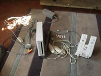 Nintendo Wii with 2 controllers and recharge station