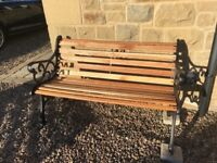 Restored garden bench with original cast iron seat ends.