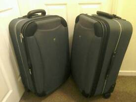 2 second hand expandable suitcases
