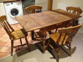 Beech wooden extendable dining table with four matching chairs