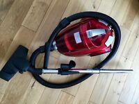 Small compact vacuum cleaner