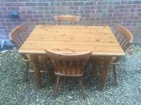 Solid pine dining table and 4 chairs with cushions