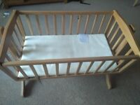 Swinging crib with mattresses never used