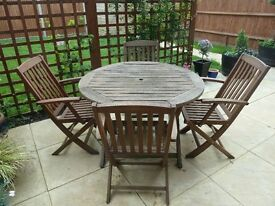 Alexander Rose Cornis solid wood round garden table & four chairs