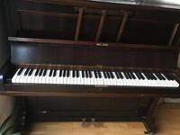 Boyd brown upright piano