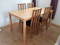 Solid wood 6-seater dining table with 4 chairs