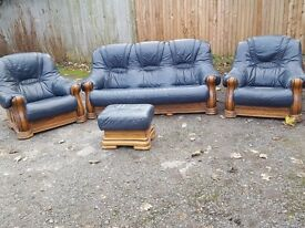 Cute blue leather sofa suite. Solid wood frame.some wear. Can deliver