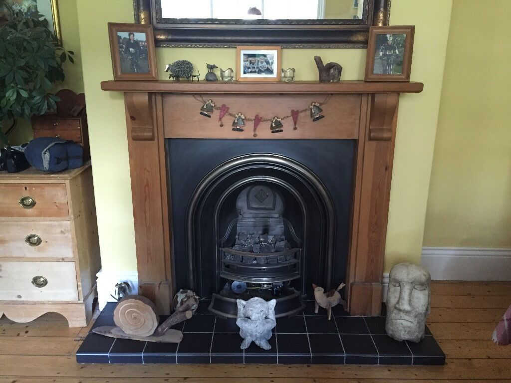 victorian cast iron fireplace with wooden surround and gas burner