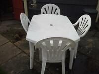 white patio table and chairs