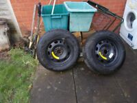 Two NEW tyres on rims.